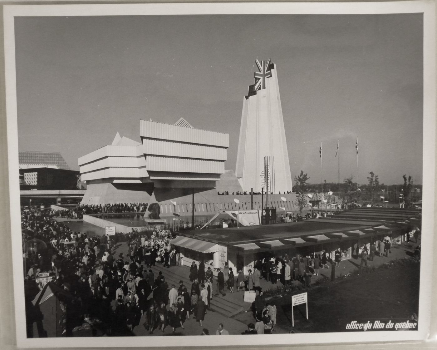 View of the Pavilion of Great Britain with boutiques in foreground, Expo 67, Montréal, Québec