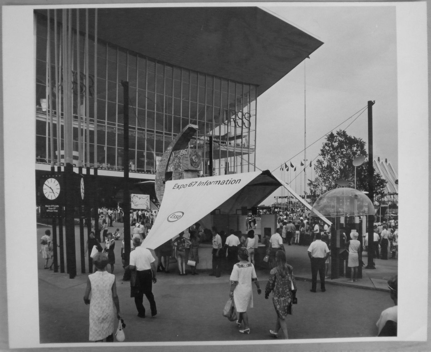 View of an information kiosk and a telephone booth in front of the Pavilion of the Soviet Union, Expo 67, Montréal, Québec
